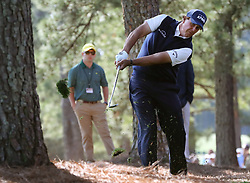 April 6, 2018 - Augusta, GA, USA - Phil Mickelson hits out of the woods off of the first fairway during the second round of the Masters at Augusta National Golf Club on Friday, April 6, 2018, in Augusta, Ga. (Credit Image: © Jason Getz/TNS via ZUMA Wire)