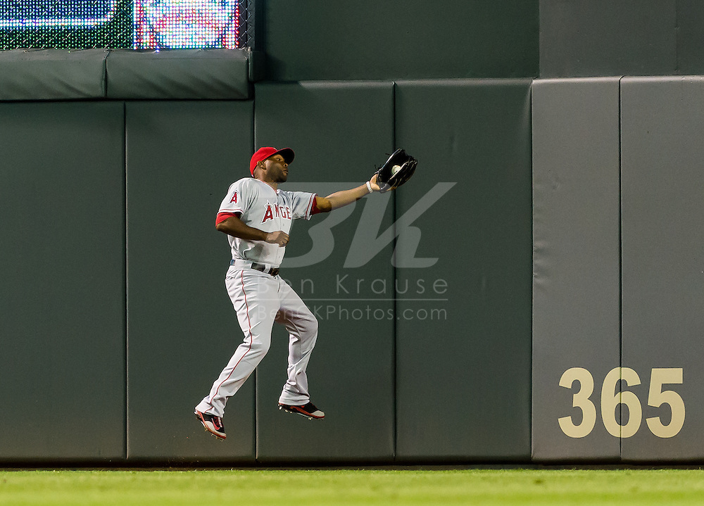 Los Angeles Angels Torii Hunter makes a catch in right field against the Minnesota Twins on May 8, 2012 at Target Field in Minneapolis, Minnesota.  The Twins defeated the Angels 5 to 0. © 2012 Ben Krause