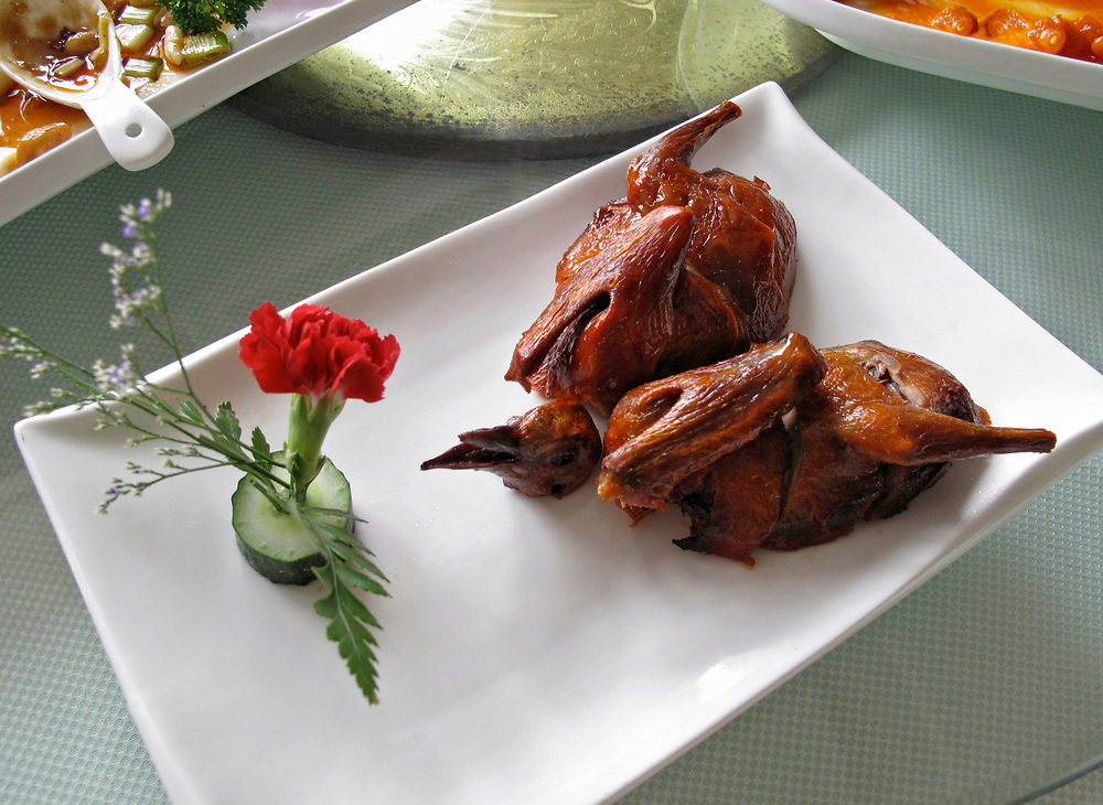 Chinese Roast Pigeon dinner on a rectangular white plate