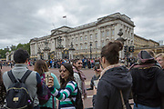 Tourists gather at Buckingham Palace to witness Changing of the Guards on the 27th August 2018 in Central London in the United Kingdom.