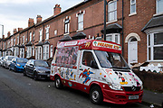 While the second national lockdown continues with just a week before the new three tier system begins, an ice cream van Paradise Ices is parked up on a residential street in Sparkhill as all non-essential shops are closed on 24th November 2020 in Birmingham, United Kingdom. The national lockdown is a huge blow to the economy and for individual businesses who were already struggling with only offering limited services.