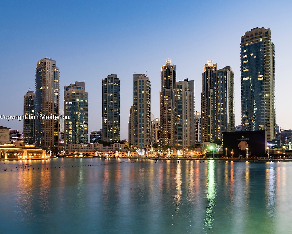 Night view of many high-rise luxury apartment towers in Downtown Dubai United Arab Emirates