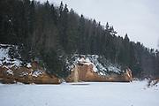 "Sandstone cliff ""Ērgļu klintis"" and frozen waterfall along frozen river Gauja, Gauja National Park (Gaujas Nacionālais parks), Latvia Ⓒ Davis Ulands | davisulands.com"