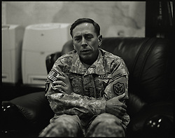 Army General David Petraeus speaks to a reporter on Sept.  4, 2008 - in his office at the US Embassy in Baghdad - during the last days in his position as commander of all coalition forces in Iraq before he transfer to command of the US Central Command which oversees the wars in Iraq and Afghanistan.