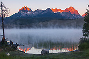 Litttle Redfish Lake, SNRA, Idaho - red glow and reflections of Mt. Heyburn from the rising sun