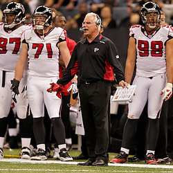 2009 November 02: Atlanta Falcons head coach Mike Smith questions an officials call in the second half against the New Orleans Saints during a 35-27 win by the Saints over the Falcons at the Louisiana Superdome in New Orleans, Louisiana.