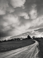 threatening clouds as a thunderstorm clears over a country road in norhtern Vermont