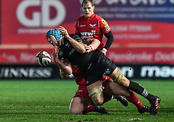 Ospreys' Justin Tipuric is tackled by Scarlets' Wyn Jones - Mandatory by-line: Craig Thomas/Replay images - 26/12/2017 - RUGBY - Parc y Scarlets - Llanelli, Wales - Scarlets v Ospreys - Guinness Pro 14