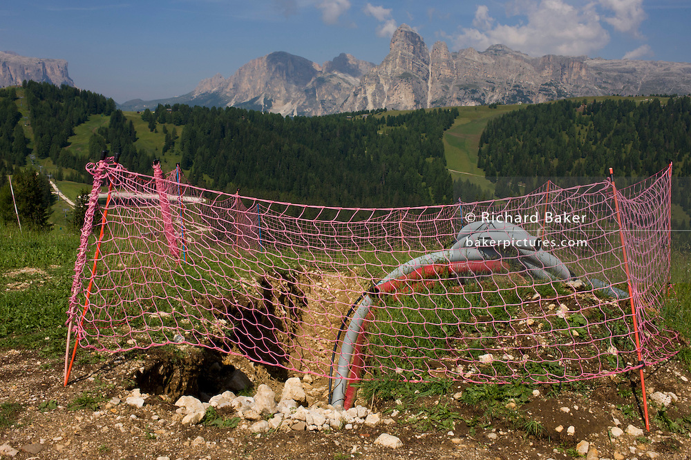 Construction work materials in the Pralongià above San Cassiano-St. Kassian in the Dolomites, south Tyrol, northern Italy. In winter, the Pralongià meadows are the heart of Alta Badia's skiing area.