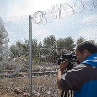 Cameraman records a stack of razor wire attached on a cargo train sealing an opening on the fence on the border between Serbia and Hungary near Roszke (about 174 km South of capital city Budapest), Hungary on September 15, 2015. ATTILA VOLGYI