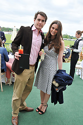 MATTHEW MOORE and ANNABELLE SPRANKLEN at the St.Regis International Polo Cup between England and South America held at Cowdray Park, West Sussex on 18th May 2013.  South America won by 11 goals to 9 goals.