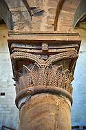 Romanesque column capital in the 8th century Romanesque Basilica church of St Peters, Tuscania, Lazio, Italy .<br /> <br /> Visit our ITALY PHOTO COLLECTION for more   photos of Italy to download or buy as prints https://funkystock.photoshelter.com/gallery-collection/2b-Pictures-Images-of-Italy-Photos-of-Italian-Historic-Landmark-Sites/C0000qxA2zGFjd_k .<br /> <br /> Visit our MEDIEVAL PHOTO COLLECTIONS for more   photos  to download or buy as prints https://funkystock.photoshelter.com/gallery-collection/Medieval-Middle-Ages-Historic-Places-Arcaeological-Sites-Pictures-Images-of/C0000B5ZA54_WD0s