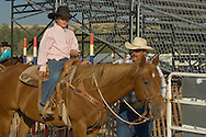 Young cowboy with horse gets instructions from father at kids rodeo,  Livingston Montana