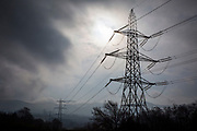 Electricity Pylons across a Welsh valley on the outskirts of Bethesda. Energy Local Bethesda, North Wales. © Andy Aitchison / Ashden