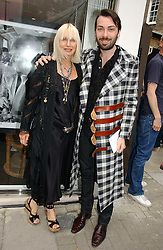 VIRGINIA BATES and JAMES LONG at an exhibition of rock photographer Mick Rock's exclusive 'the One and Only' photographic prints held at Notting Hill's newly opened boutique 'One' 30 Ledbury Street, London W11 on 22nd June 2006.<br /><br />NON EXCLUSIVE - WORLD RIGHTS