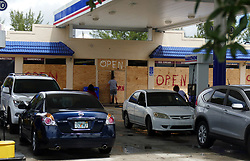 The Marathon gas store at NW 27th Place and NW 119th Street has their windows boarded but gas was still flowing at 12:45 p.m. on Wednesday, September 6, 2017. Photo by Emily Michot/Miami Herald/TNS/ABACAPRESS.COM