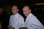 Laurent Pourcel and Jacques Pourcel. W'Sens-restaurant launch party. 12 Waterloo Place. 10 December 2004. ONE TIME USE ONLY - DO NOT ARCHIVE  © Copyright Photograph by Dafydd Jones 66 Stockwell Park Rd. London SW9 0DA Tel 020 7733 0108 www.dafjones.com