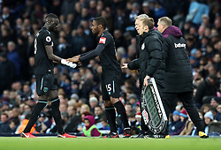 West Ham United's Diafra Sakho (centre) is substituted onto the pitch to replace Cheikhou Kouyate (left) during the Premier League match at the Etihad Stadium, Manchester.