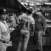 Bryce Harper, Washington Nationals, in the dugout, has his hair checked by Matt Williams, Washington Nationals Manager, before the New York Mets Vs Washington Nationals MLB regular season baseball game at Citi Field, Queens, New York. USA. 31st July 2015. Photo Tim Clayton