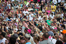 © Licensed to London News Pictures . 08/08/2015 . Siddington , UK . The crowd at The Rewind Festival of 1980s music , fashion and culture at Capesthorne Hall in Macclesfield . Photo credit: Joel Goodman/LNP
