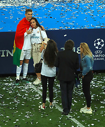 Real Madrid's Cristiano Ronaldo poses for photographs with girlfriend Georgina Rodriguez after winning the UEFA Champions League Final at the NSK Olimpiyskiy Stadium, Kiev.