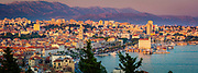 """Split is a city in Central Dalmatia, Croatia. The city was originally built around the Diocletian palace (a palace/fort built for the retired Roman emperor Diocletian) where the locals sought refuge centuries ago. Despite initial appearances, however, the city is not a small tourist town, and extends over a large area well beyond the ancient core. With over 300,000 people in the wider bay area, its the economic hub of the eastern Adriatic shoreline (the unofficial """"capital"""" of Dalmatia). Wandering the historic centre of Split you can still clearly see the Roman walls, squares, and temples."""