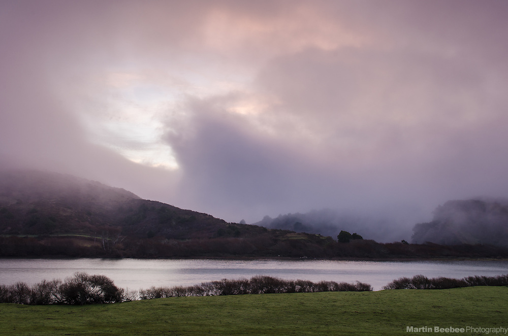 Morning fog lifting above the Russian River near Jenner, Sonoma County, California