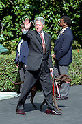 US President Clinton with dog Buddy wave before boarding Marine One helicopter on the South Lawn of the White House August 19, 1999 in Washington, DC. Clinton, who is celebrating his fifty-third birthday Thursday, and his family are traveling to Martha's Vineyard for a vacation.