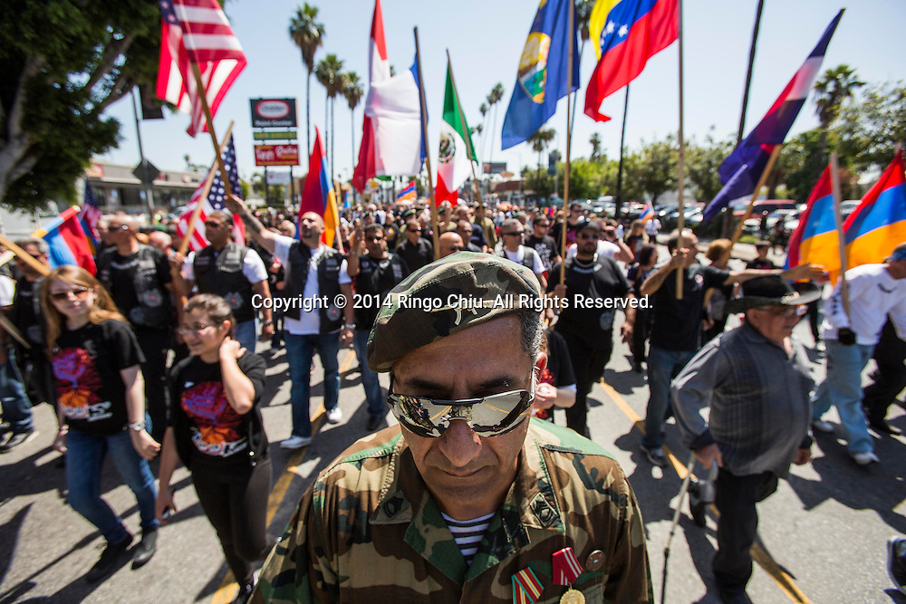 Kajchik Piliposyan wears army uniform as thousands of Armenians march along Hollywood Boulevard to mark the 99th anniversary of the beginning of the Armenian genocide and to call on the Turkish government to recognize the deaths of about 1.5 million people, in Los Angeles on Thursday, April 24, 2014. (Photo by Ringo Chiu/PHOTOFORMULA.com)