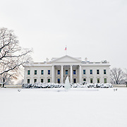 The White House on a snowy winter's morning with a fresh blanket of snow on the ground