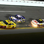 Joey Logano (22), Martin Truex Jr. (56) and Greg Biffle (16), are seen in turn four of the NASCAR Sprint Unlimited Race at Daytona International Speedway on Saturday, February 16, 2013 in Daytona Beach, Florida.  (AP Photo/Alex Menendez)