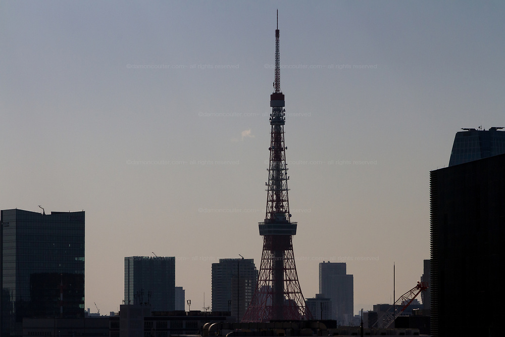 Tokyo Tpwer  and skyline in silhouette from Ginza, Tokyo, Japan. Wednesday February 5th 2020