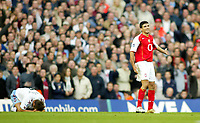 16/10/2004<br />FA Barclays Premiership - Arsenal v Aston Villa - HIghbury<br />Arsenal's Jose Antonio Reyes protests his innocence over Aston Villa's Lee Hendrie, who is lying on the grass, after apparently touching heads during an argument<br />Photo:Jed Leicester/BPI (back page images)