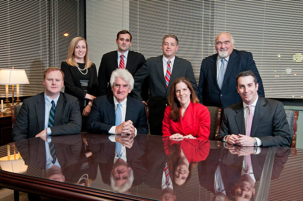 Chief Executive Officer of O'Neill and Associates Thomas O'Neill III with employees at the firm's downtown offices, Boston, MA.