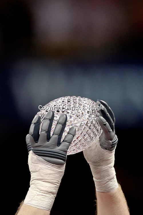 Jan 9, 2012; New Orleans, LA, USA; A Alabama Crimson Tide player raises  The Coaches Trophy crystal football in celebration after the 2012 BCS National Championship game win over the LSU Tigers at the Mercedes-Benz Superdome.  Mandatory Credit: Derick E. Hingle-USA TODAY SPORTS