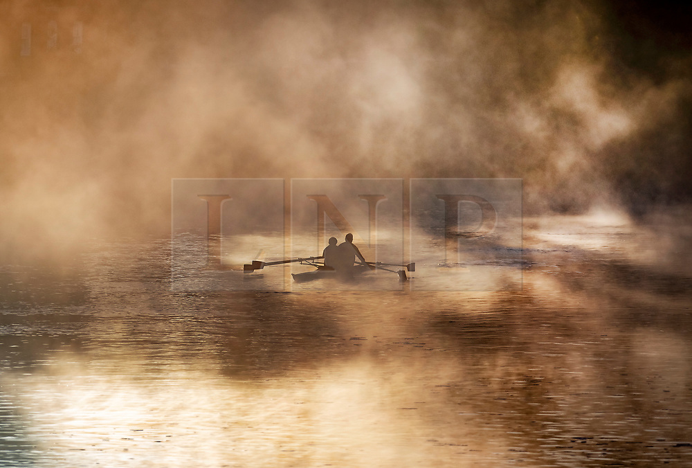 © Licensed to London News Pictures. 04/11/2020. Hampton Court, UK. Rowers train on a misty River Thames at Hampton Court at sunrise. Low autumnal temperatures are expected in parts of the United Kingdom today. Photo credit: Peter Macdiarmid/LNP