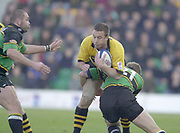 Northampton, Northamptonshire, UK, 08.12.2001, Wasps's captain Mark Denney,  is stopped by Alistair McKenzie, Northampton Saints vs  London Wasps, Zurich Premiership Rugby, Franklyn Gardens, [Mandatory Credit: Peter Spurrier/Intersport Images]