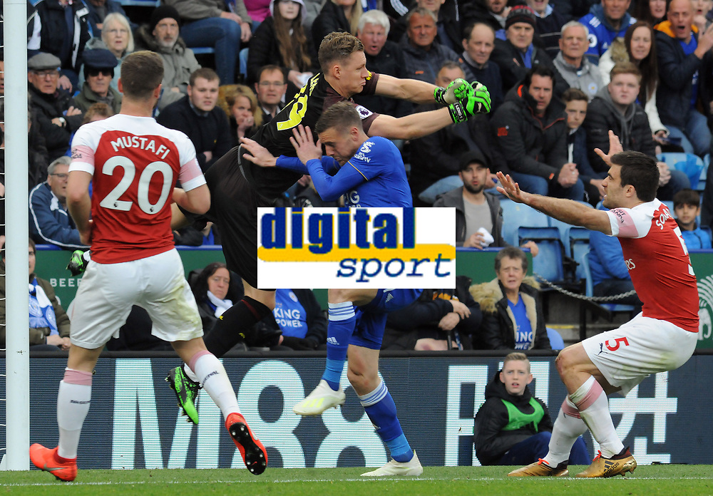 Football - 2018 / 2019 Premier League - Leicester City vs. Arsenal<br /> <br /> Arsenal goalkeeper, Bernd Leno punches clear from the oncoming Jamie Vardy, at King Power Stadium.<br /> <br /> COLORSPORT/ANDREW COWIE