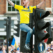 A Chelsea fan celebrates on top of a traffic light during the Chelsea Victory Parade at Eelbrook Common to commentate the club winning the 2014/15 Premier League title. London, May 25, 2015.<br /> <br /> Picture by Jack Megaw/Focus Images Ltd <br /> +44 7481 764811<br /> jack@jackmegaw.com<br /> 25/05/2015