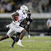 ORLANDO, FL - OCTOBER 03:  Deneric Prince #8 of the Tulsa Golden Hurricane outruns Richie Grant #27 of the Central Florida Knights at Bright House Networks Stadium on October 3, 2020 in Orlando, Florida. (Photo by Alex Menendez/Getty Images) *** Local Caption *** Deneric Prince; Richie Grant