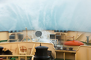 Crossing the Drake Passage -a Force 9 gale with 6m waves in the Yungan Basin. The waves were so huge that they were hitting the bar windows (which this shot was taken from) some 5 stories above the deck and 30m back from the bow!