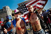 """Protesters with """"Occupy D.C."""" joined up with """"Stop the Machine"""" for a protest rally and """"occupation"""" of Freedom Plaza in Washington, D.C. on Thursday. ..Protesting against corporate greed, bad political leaders and a widening gap between the poot and the rich, vowed to stay indefinitely. The groups only have Park Service permits through Sunday."""