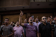 Anti government demonstrators hear news of president Morsi's arrest by the military in Tahrir Square, Cairo, Egypt