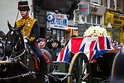 The coffin of baroness thatcher on a gun carridge  passes along Fleet Street on route to St. Paul's cathedral where her funeral took place. 17th April 2013. London, United Kingdom.