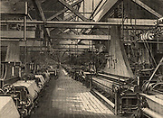 Weaving shed, Erskine Beveridge & Company's St Leonard's Factory, Dunfermline, Scotland.  This shed contained nearly 1,000 Jacquard power looms for weaving linen damask. The belt and shaft drive transmitting power to the looms from a distant steam engine is clearly visible.  From 'Great Industries of Great Britain' (London, c1880).  Engraving.