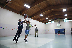 April 13, 2018 - St. Paul, MN, USA - The Scheffer Recreation Center will be completely rebuilt this year. It's included in the Parks Department's first-ever ADA Transition Plan, which lists updates the department needs to make to parks facilities over the next five years in order to comply with the ADA. Here, boys play basketball in the gym that is not large enough to hold a regulation game.   ] (No names please.)..BRIAN PETERSON • brian.peterson@startribune.com..St. Paul, MN  04/12/2018. (Credit Image: © Brian Peterson/Minneapolis Star Tribune via ZUMA Wire)