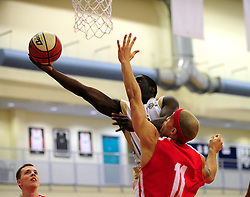 Bristol Academy Flyers' Greg Streete attempts to block a shot from Essex Leopards' Jermaine Anderson - Photo mandatory by-line: Dougie Allward/JMP - Tel: Mobile: 07966 386802 23/03/2013 - SPORT - Basketball - WISE Basketball Arena - SGS College - Bristol -  Bristol Academy Flyers V Essex Leopards