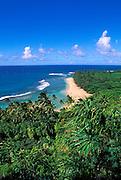 Ke'e Beach and the lush tropical landscape of the North Shore from the Kalalau Trail, Na Pali Coast, Island of Kauai, Hawaii.
