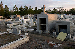 03 November, 2005.  New Orleans, Louisiana.  Post Katrina. <br /> An empty tomb at the Terre Aux Boaeufs (cattle land) cemetery in Saint Bernard parish just south of New Orleans. Hurricane Katrina caused a 20ft tidal surge to sweep over the land, 'popping' tombs and displacing coffins.<br /> Photo; ©Charlie Varley/varleypix.com