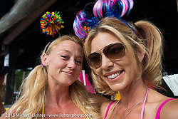 Kristi Verhoff (L) of Arizona works the Boot Hill Saloon on roller skates with a close friend on Main Street during the 2015 Biketoberfest Rally. Daytona Beach, FL, USA. October 16, 2015.  Photography ©2015 Michael Lichter.